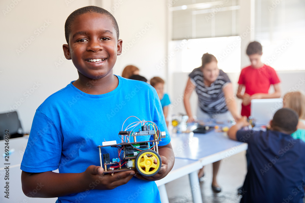 Fototapety, obrazy: Portrait Of Male Student Building Robot Vehicle In After School Computer Coding Class