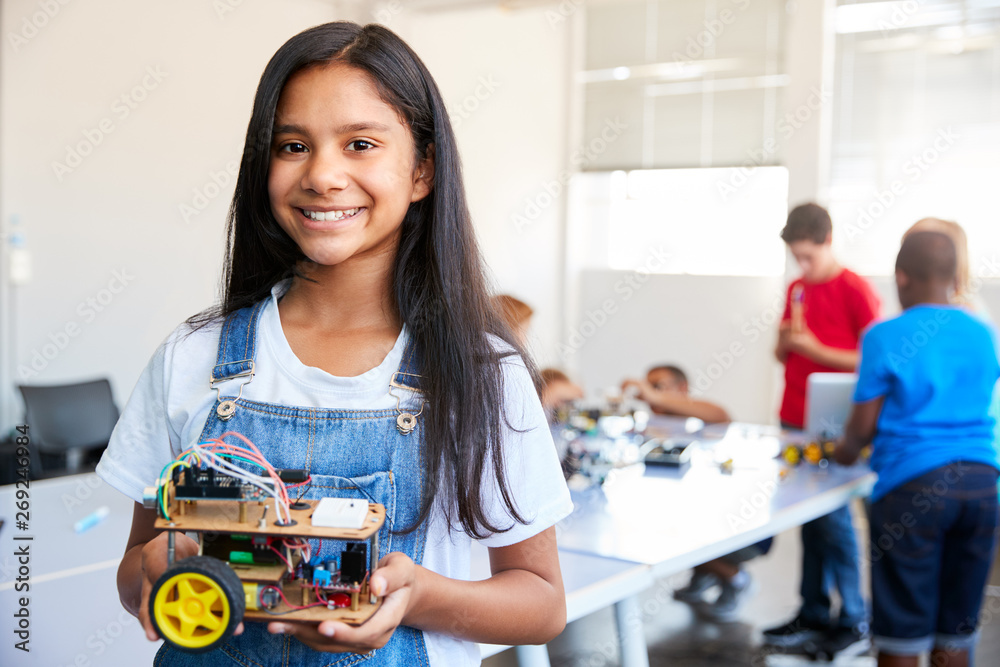 Fototapety, obrazy: Portrait Of Female Student Building Robot Vehicle In After School Computer Coding Class