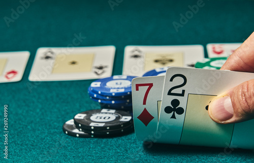Bad poker gamble or unlucky hand concept with player going all in with 2 and 7 ( Canvas Print