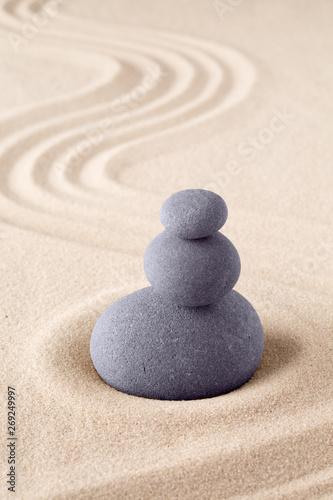 Foto op Plexiglas Stenen in het Zand Stone stack, Japanese zen sand garden with pile of rocks. Concept for balance and purity.
