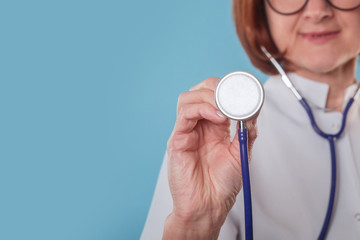 Close up shot of stethoscope holding in hand of woman doctor