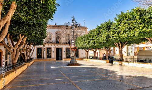 View of town hall building and square in picturesque Nijar, Almeria, Spain.