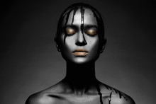 Young Woman In Black Paint Wit...