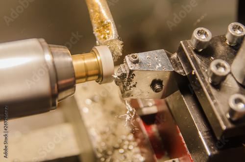 Fototapety, obrazy: Machining of cylindrical parts on a lathe machine.