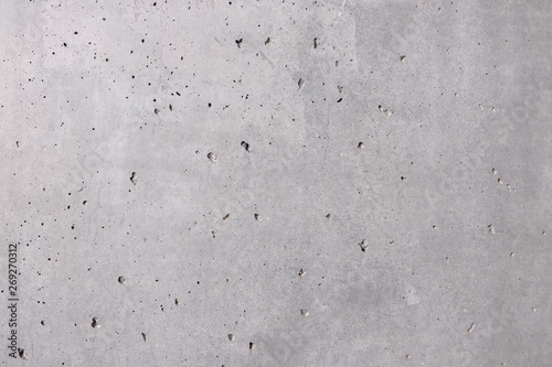 Grauer Hintergrund, Steinwand in grau mit locker verteilten löcher und leicht rauer Oberfläöche als Hintergund und Textur Wallpaper Mural