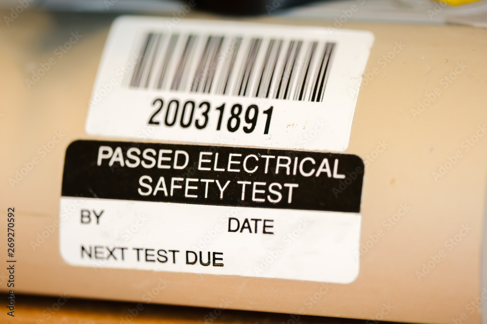 Fototapeta Sticker on an electrical appliance stating that it has passed a safety test