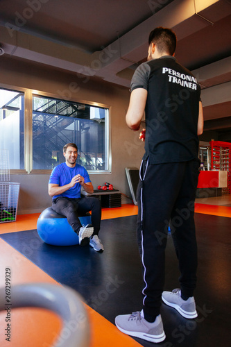 new gym member training with a healthy instructor  Personal