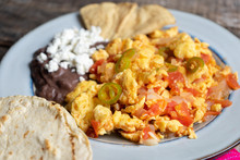 Mexican Style Scrambled Eggs With Fried Beans, Cheese And Jalapeno