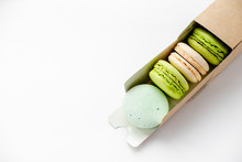 Assorted Macaroons In Craft Pa...