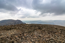 Scafell Pike Summit With Dramatic Grey Clouds, Lake District, England, UK