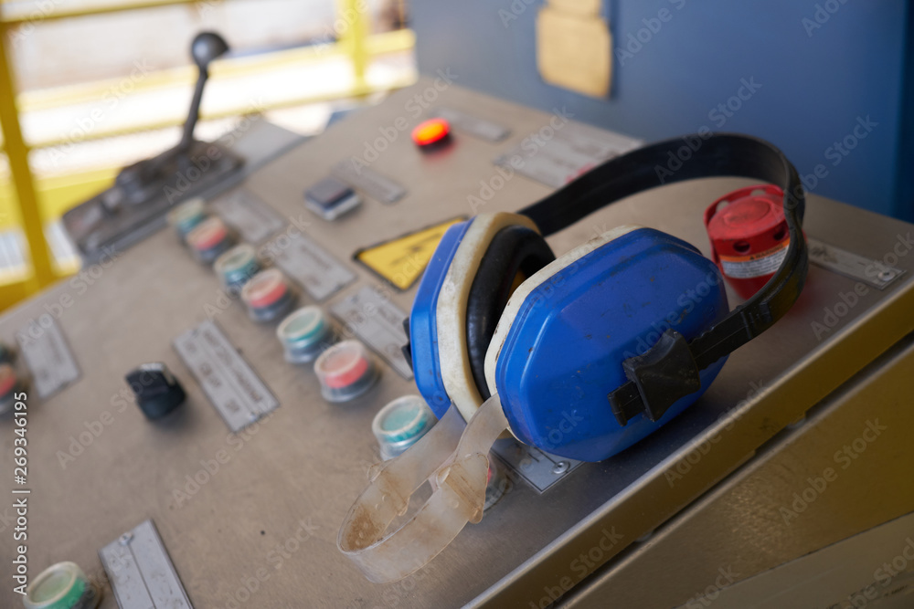 Fototapeta pump control panel on which the headphones are located to protect the ears from excessive noise