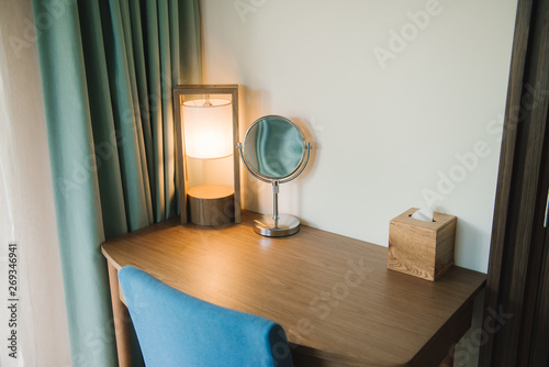Stampa su Tela Makeup table and oval mirror in bedroom.