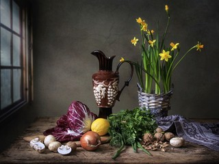 Still life with radicchio salad and daffodils bouquet