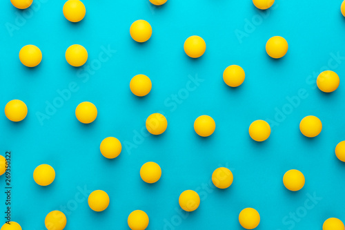 many balls for table tennis on turquoise blue background Canvas-taulu