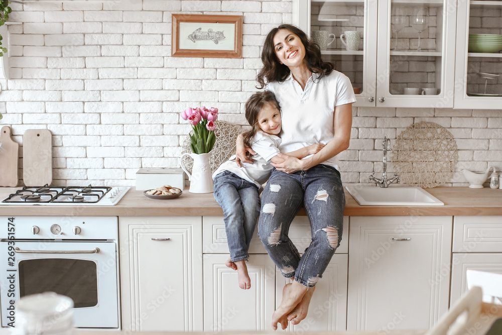 Fototapety, obrazy: Happy mother with daughter in kitchen at home