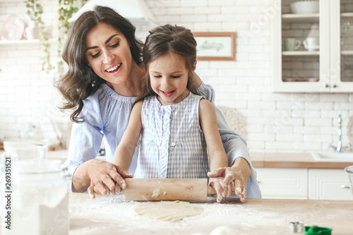 Happy mother with daughter preparing cookies in kitchen at home Canvas Print