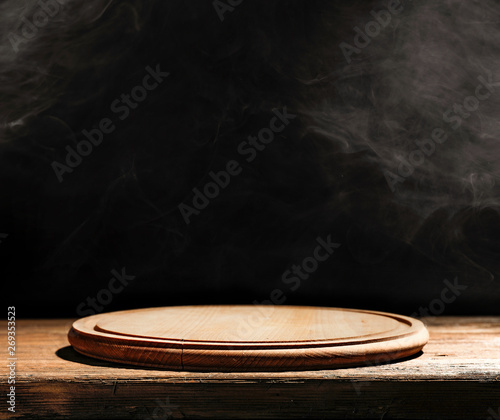 Tuinposter Hoogte schaal Wooden desk space and black bakcground of free space for your decoration.