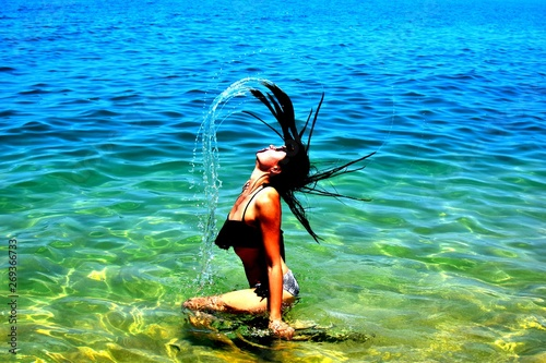 woman playing in water