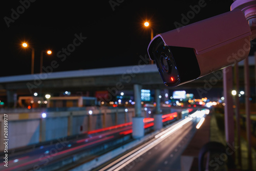 Photo sur Toile Londres bus rouge CCTV surveillance camera operating on traffic road