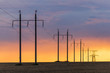 Epic sunset with rural landscape with high-voltage line