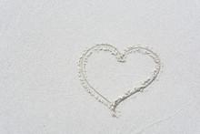 Drawn Love Heart Shape On White Sand Beach Background