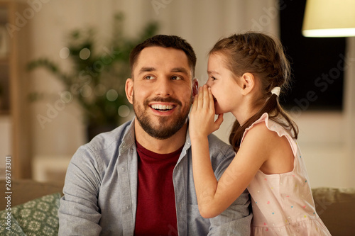 family, fatherhood, leisure and people concept - happy daughter whispering secre Wallpaper Mural