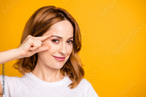 Tuinposter Hoogte schaal Close up photo beautiful amazing she her foxy lady hold arm hand face cheek cheekbone applying nourishing anti-age cream pure skin no wrinkles wear casual white t-shirt isolated yellow background