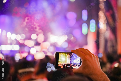 Photo  Close up of recording video with smartphone during a concert