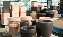 Image Of Rows With Clay Pots F...