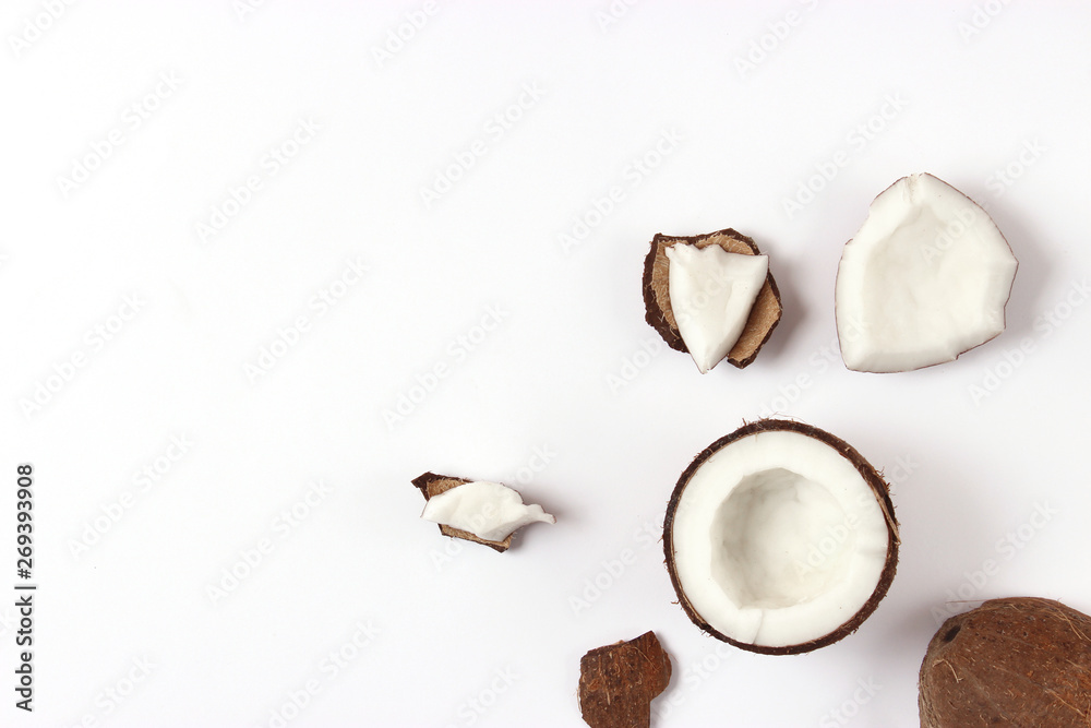 Fototapety, obrazy: broken coconut on a white background top view.