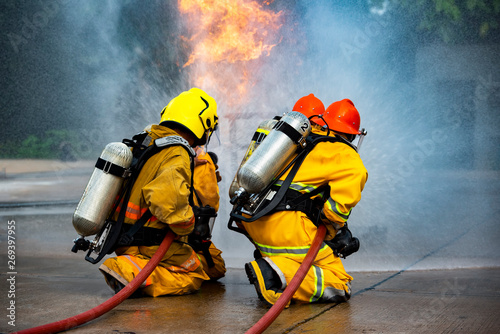 Firefighters spray high-pressure water to areas that are copied in practice.
