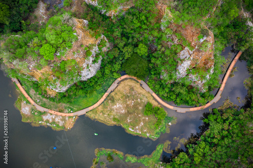 Foto op Plexiglas Groene aerial over view khao ngoo mountain rock or snake mountain rock are high cliff and landmark ratchaburi province thailand