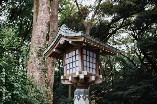 Japanese style wooden lantern With trees on background  in Meiji Shrine, Shibuya, Japan Fototapeta
