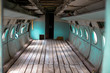 Inside a very old plane. Passenger cabin of a small old plane.
