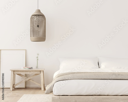 Fotografía  Stylish bedroom interior in beige color with wooden bench, wicker chandelier and