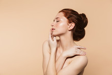 Amazing Young Redhead Woman Posing Isolated Over Beige Wall Background.