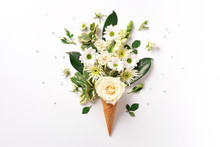Summer Minimal Concept. Ice Cream Cone With White Flowers And Leaves On Light Background. Flat Lay. Top View. Creative Layout