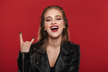 Beautiful Young Laughing Happy Emotional Woman With Bright Makeup Red Lipstick Posing Isolated Over Red Wall Background.