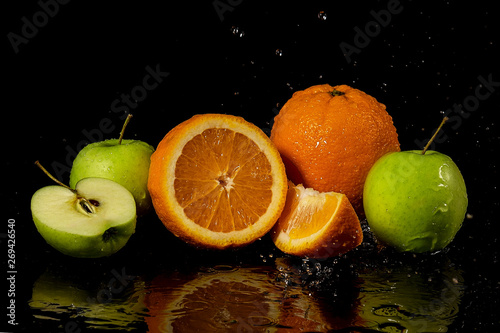 Poster Fruits fresh fruit on a black background. healthy food. diet