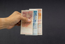 Hand Holding Fifty Croatian KUNA Or STO KUNA Bank Notes On Black Background. Financial Concept And Selective Focus