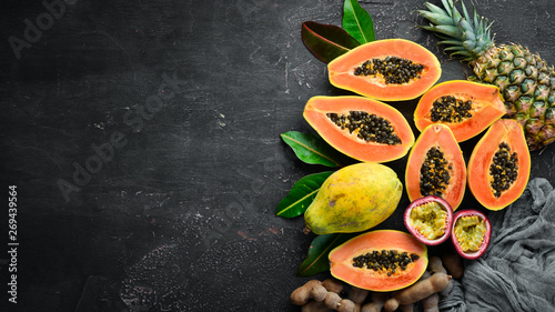 Papaya fruit on a wooden background. Tropical Fruits. Top view. Free space for text. - 269439564