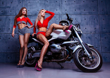 Two Beautiful Sexy Women Wearing Costumes Of  Racers
