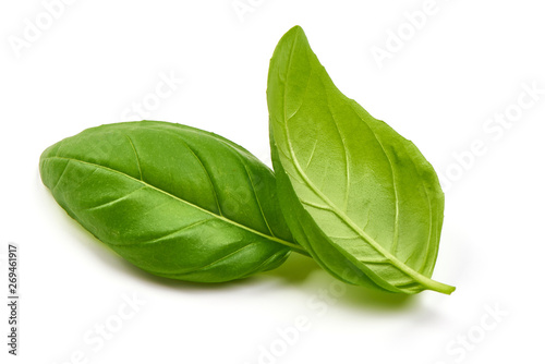 Foto Fresh basil leaves, close-up, isolated on white background