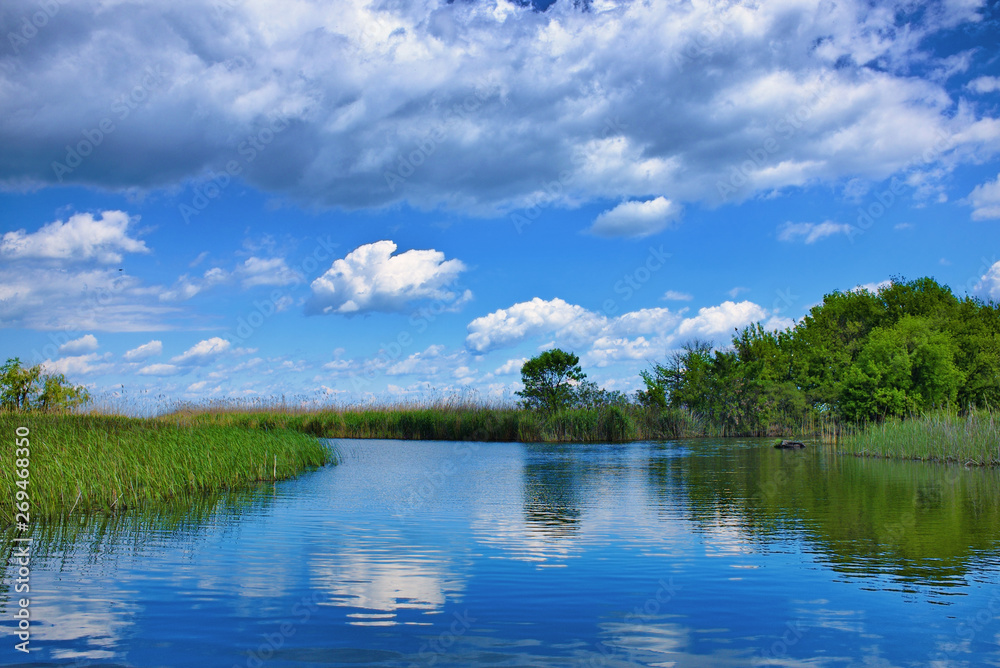 Fototapeta The beautiful Tisza lake with a nice cloudscape and a nice reflection on the water