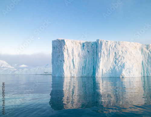 The glaciers are melting on arctic ocean in Greenland. Big glaciers day by day broking and dangerous for world climate system. Shooting day was foggy weather and glaciers didn't look clear.  Fototapete