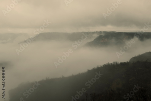 Wall Murals Cappuccino Low cloud in a valley in the mountains.
