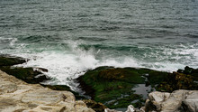 Waves Splashing Onto A Stone In Beavertail, Rhode Island