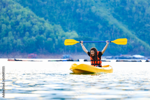 Fotografie, Obraz  kayaking on the lake and sunset on behind the mountain background