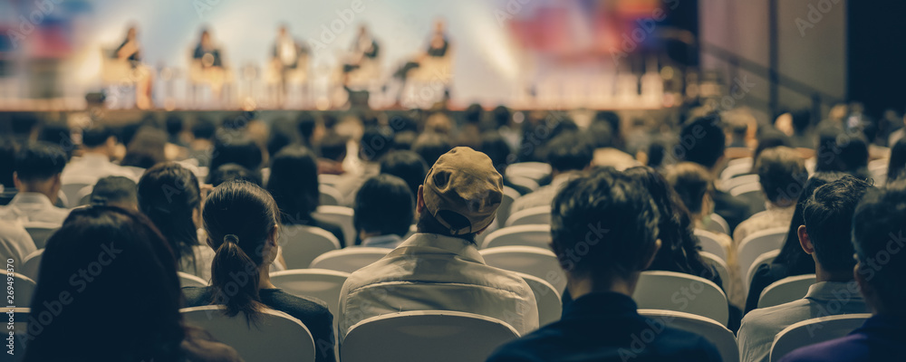 Fototapeta Banner cover page of Rear view of Audience listening Speakers on the stage in the conference hall or seminar meeting, business and education about investment concept
