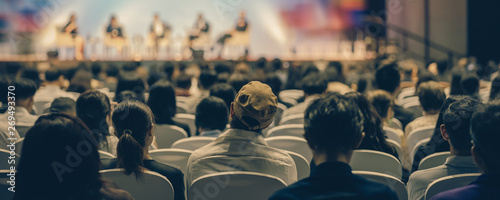 Obraz Banner cover page of Rear view of Audience listening Speakers on the stage in the conference hall or seminar meeting, business and education about investment concept - fototapety do salonu